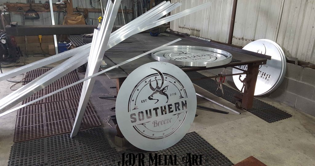 Saw and plasma cut material for custom aluminum gate and sign order.