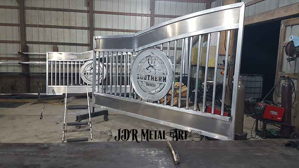 Aluminum gate panel with plasma cut design.