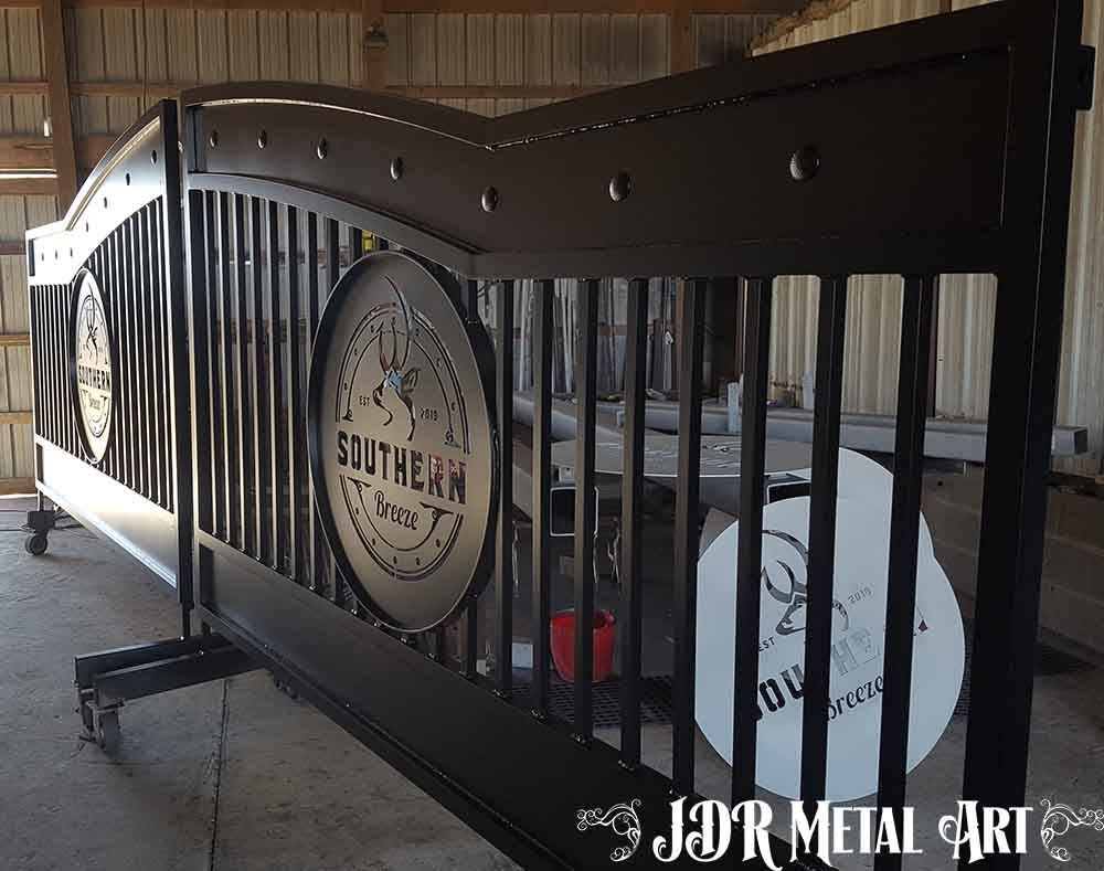 Custom aluminum driveway gates with black powder coat finish.