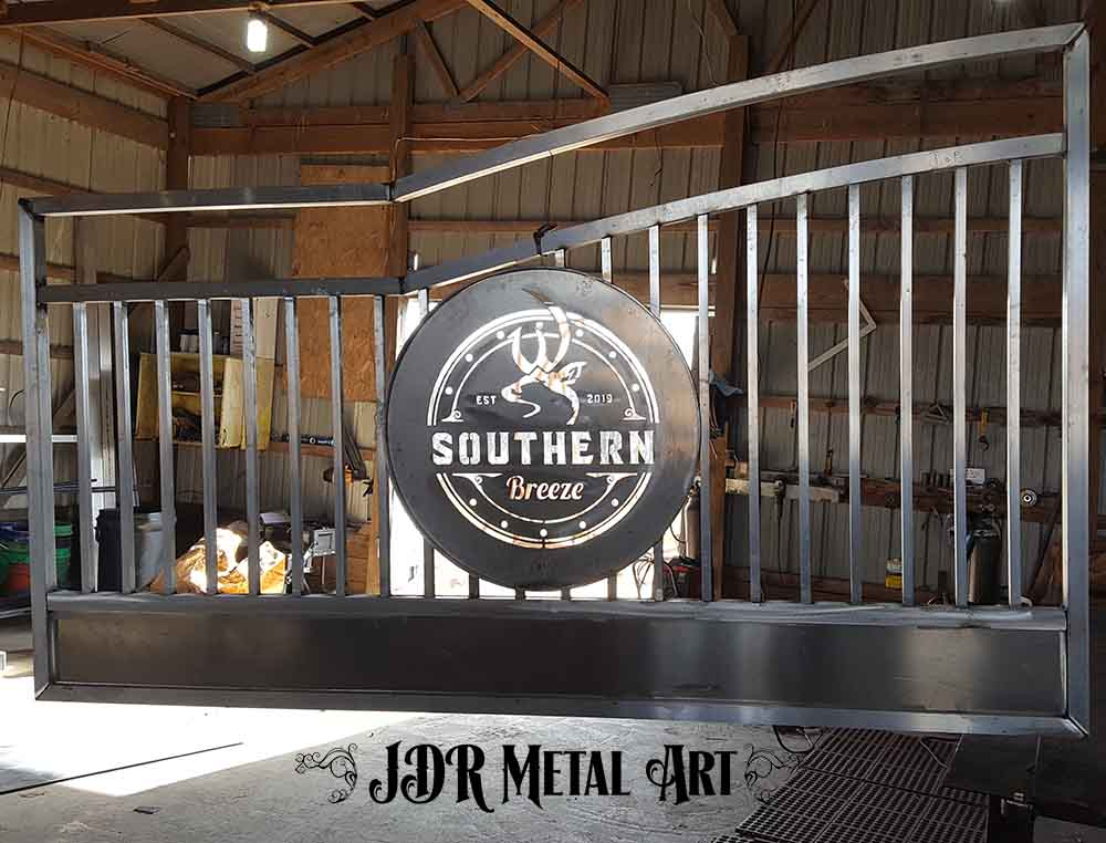 Aluminum picket gate frame and plasma cut logo.