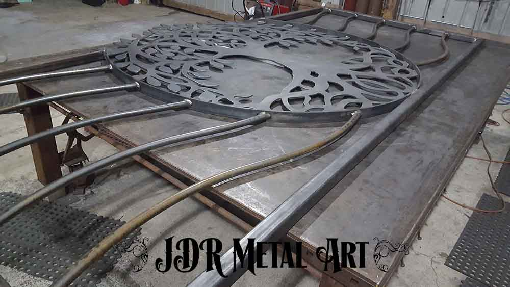 Back side of welded steel tree of life gate.
