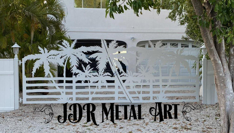Driveway gate with palm tree design at residence in Marathon, Florida.
