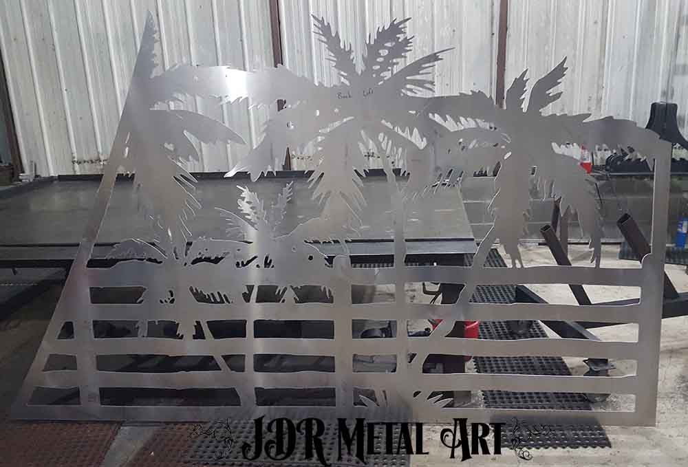Silhouette of palm tree plasma cut from aluminum.