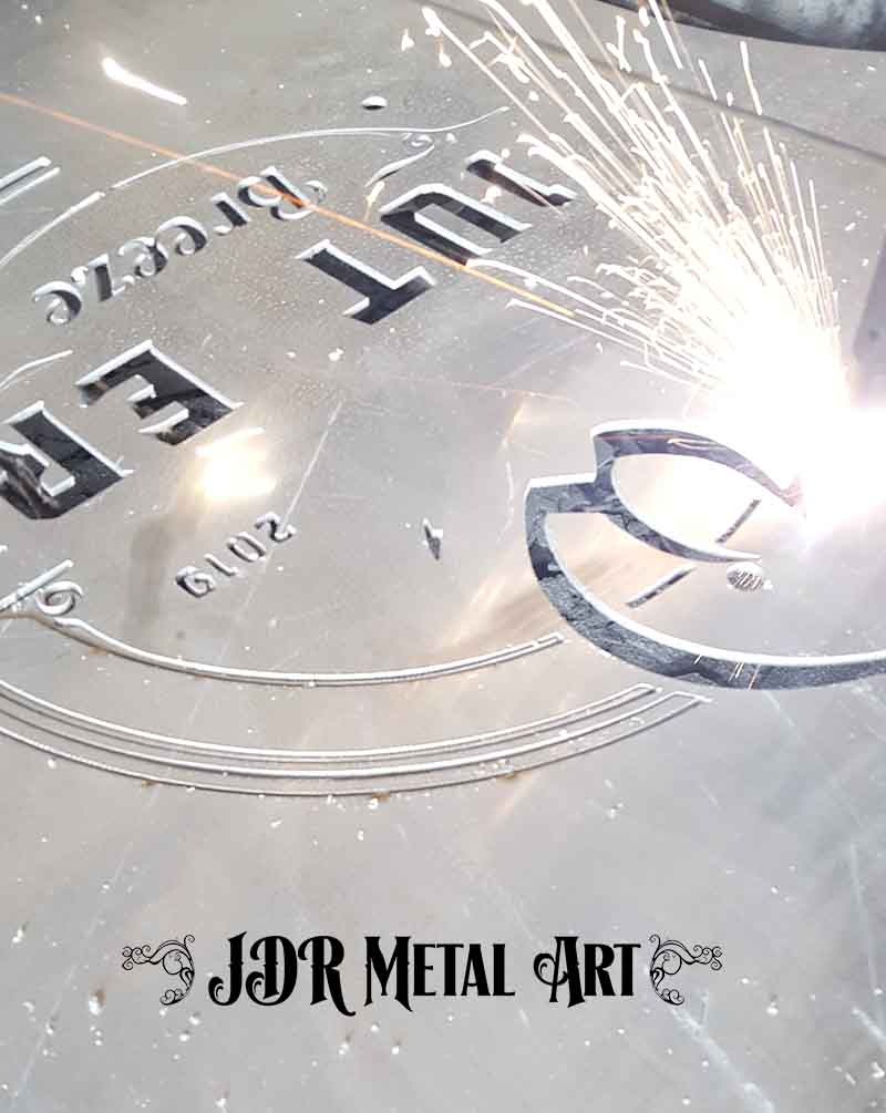"Hypertherm plasma torch cutting metal design logo from aluminum 3/16"" thick."