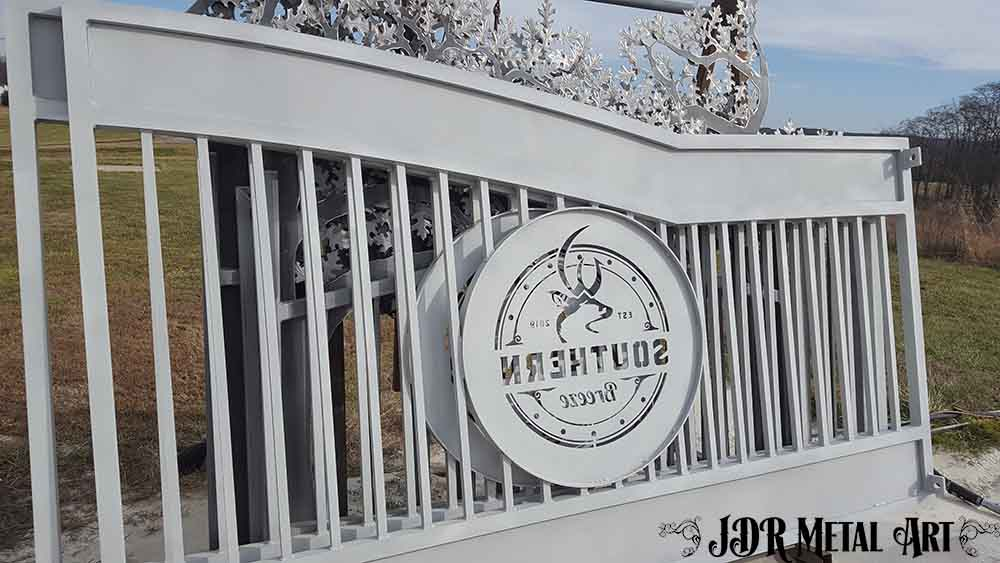 Custom aluminum driveway gate that was sandblasted.