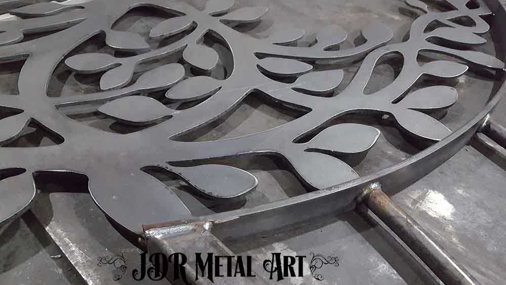 Welded custom gate pickets and tree of life cutout