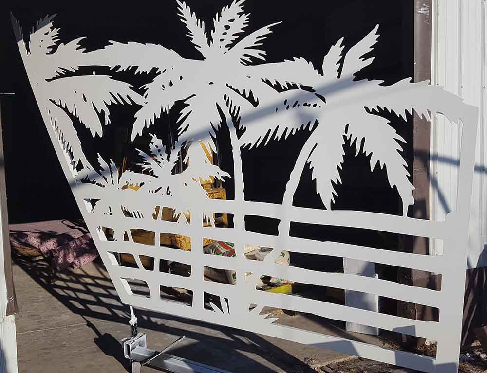 Palm tree gate panel after white powder coat finish was applied.