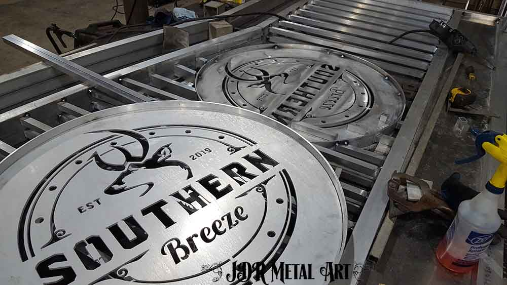 Building an aluminum gate with logos.