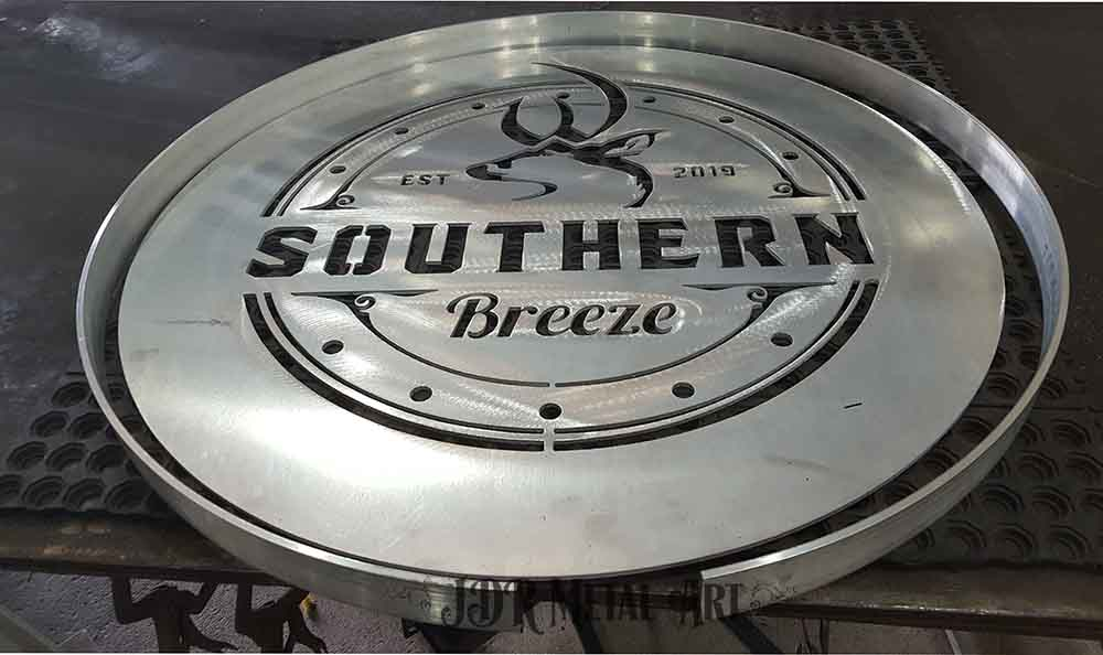 Custom plasma cut gate logo.