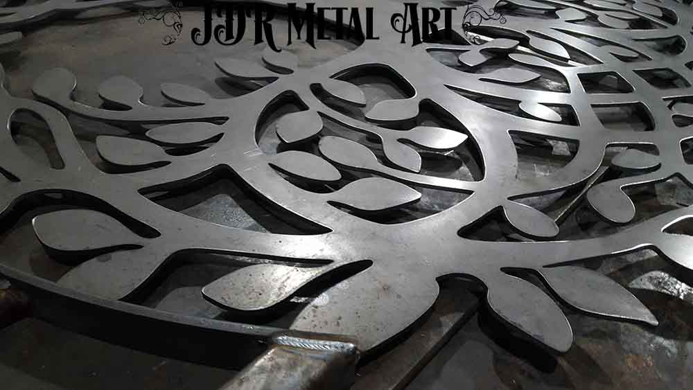 Whimsical tree design plasma cut from steel.