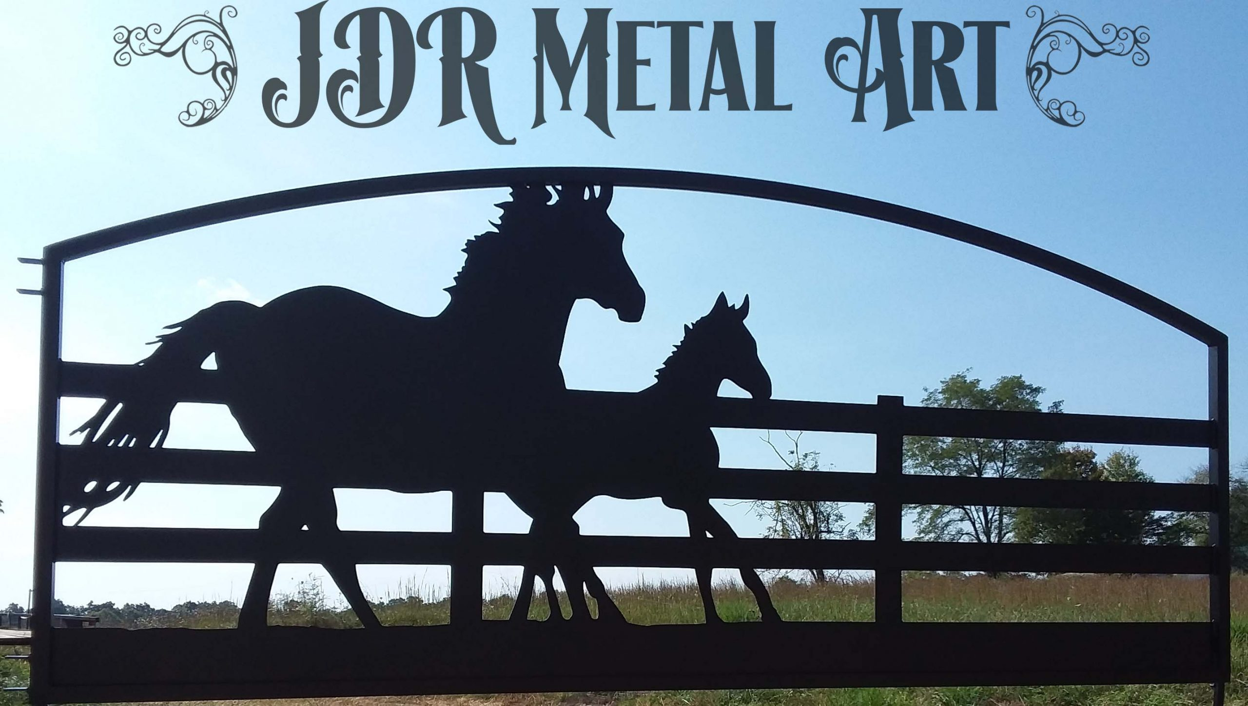 Driveway gates made from aluminum for sale to client in Oregon, the design features a running mare and foal running alongside a fence. The gate is 14' and is a single swing.