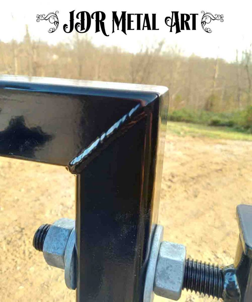 Mig weld steel on driveway gate panel.