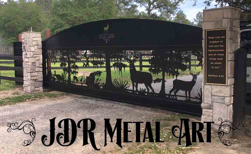 Florida driveway gates with sliding deer and cypress gate design.