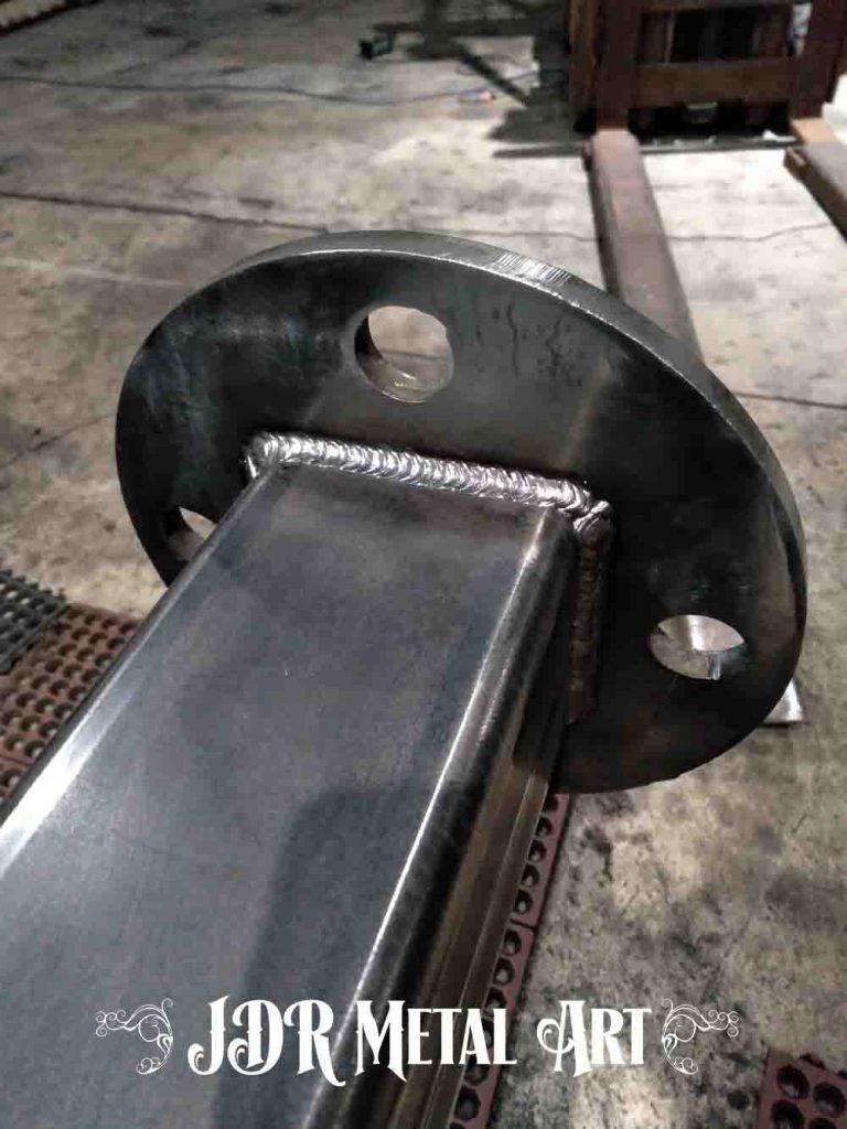 """Steel gate post base plate cut from 1/2"""" steel."""