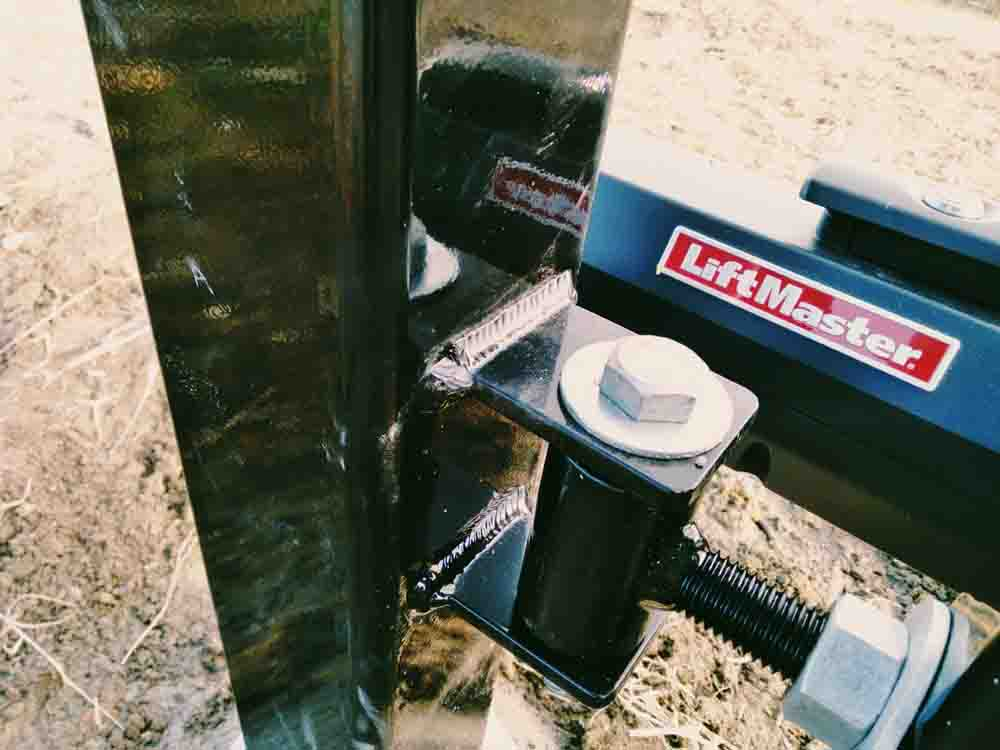 Liftmaster LA 500 is the best gate opener and is mounted to this hinged gate post.