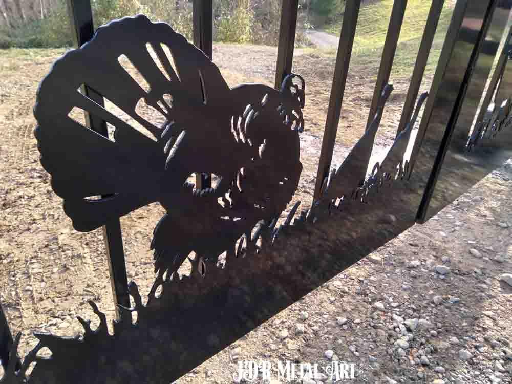 Plasma cut turkeys on ranch gate