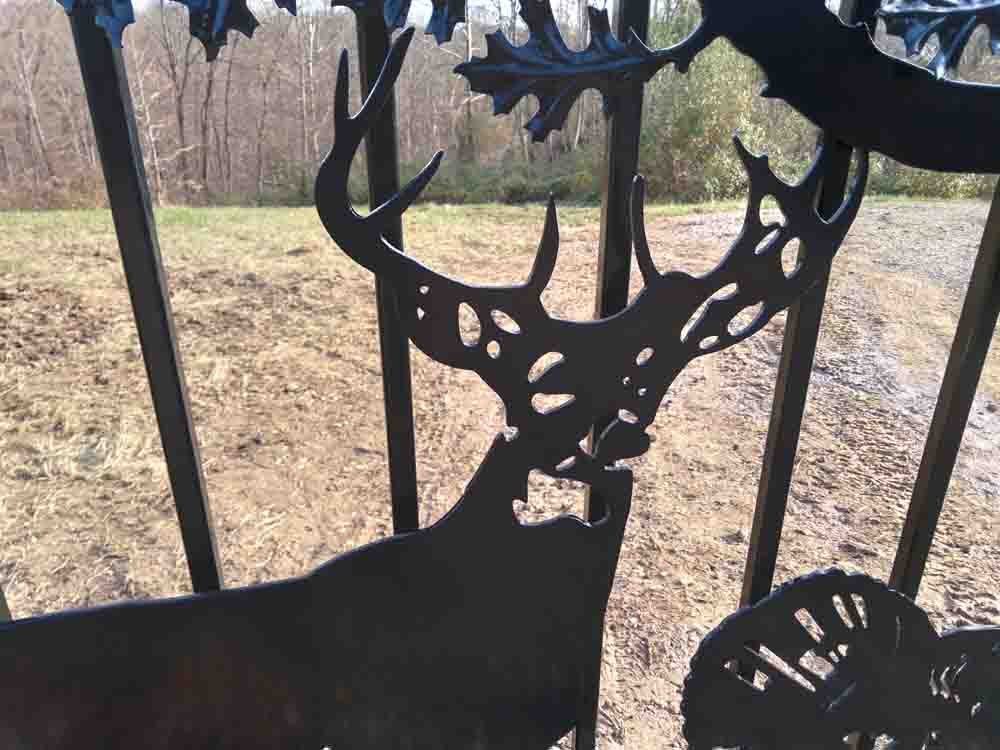 whitetail buck on driveway gate by JDR Metal Art