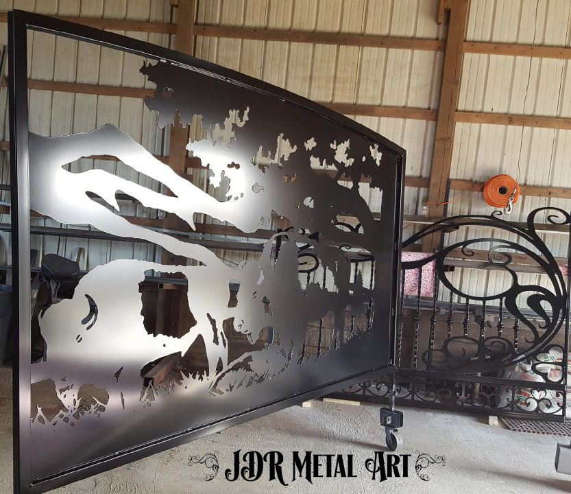 Plasma cut bison made from steel with arched top on swinging gate for Alabama bison farm.