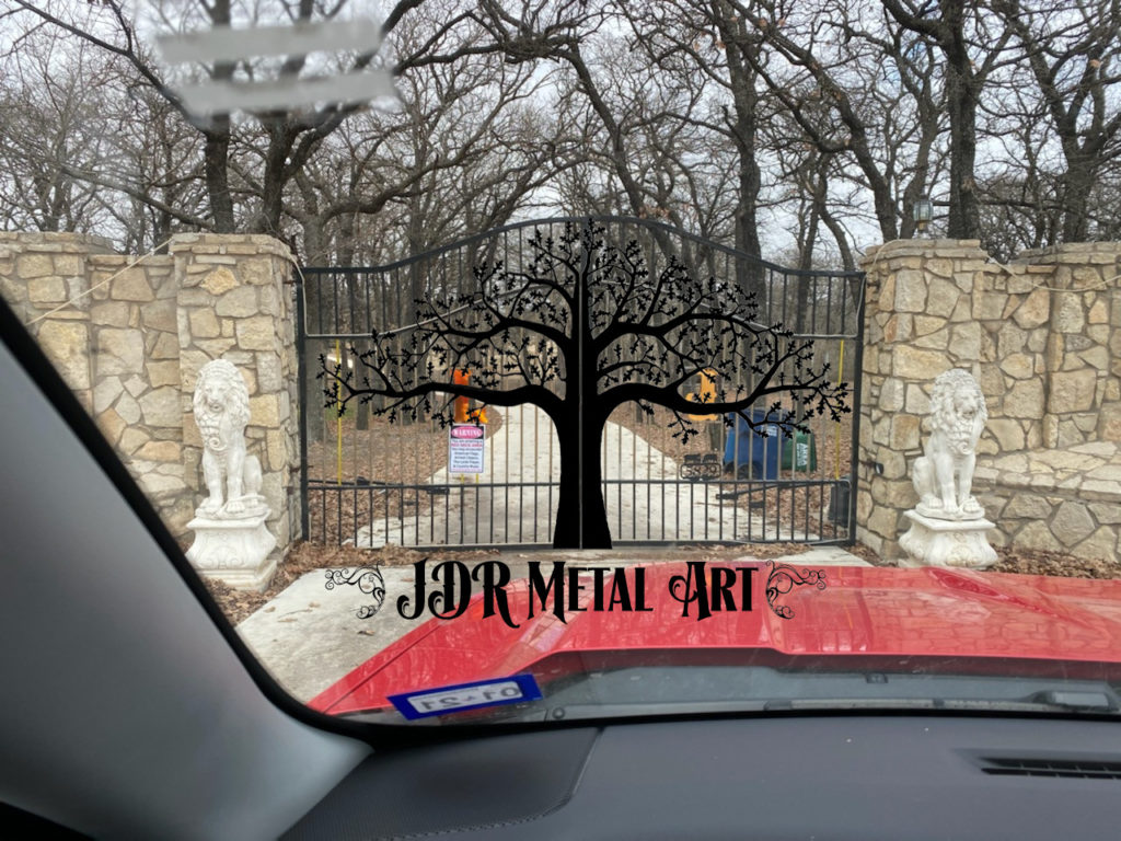 Driveway gates in DFW with decorative/ornamental oak tree.