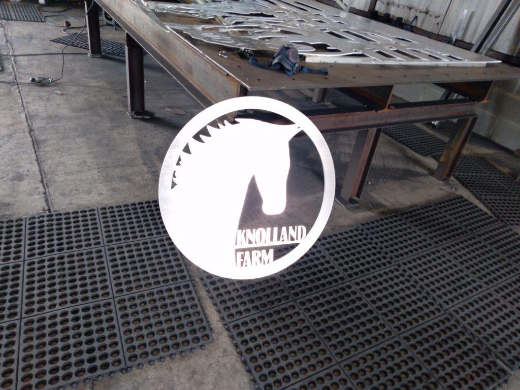 Shiny aluminum metal art farm sign plasma cut by JDR Metal Art.