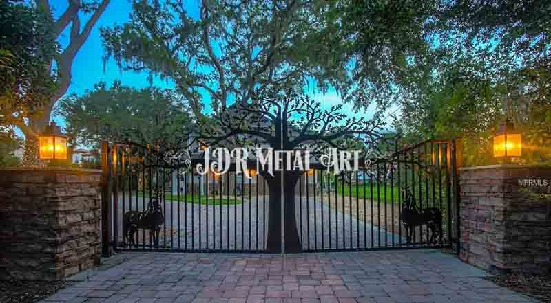 Driveway Gates for Orlando, Florida driveway entrance with horses and oak tree.