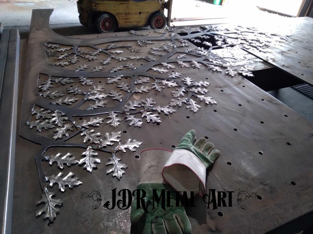 Metal oak tree on steel welding table.
