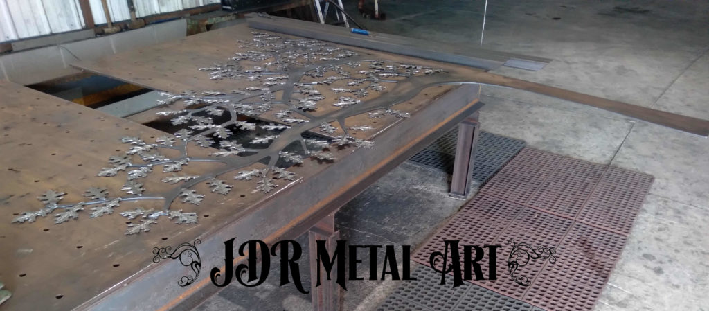 Fabricating metal decorative tree for a driveway gate in Dallas.