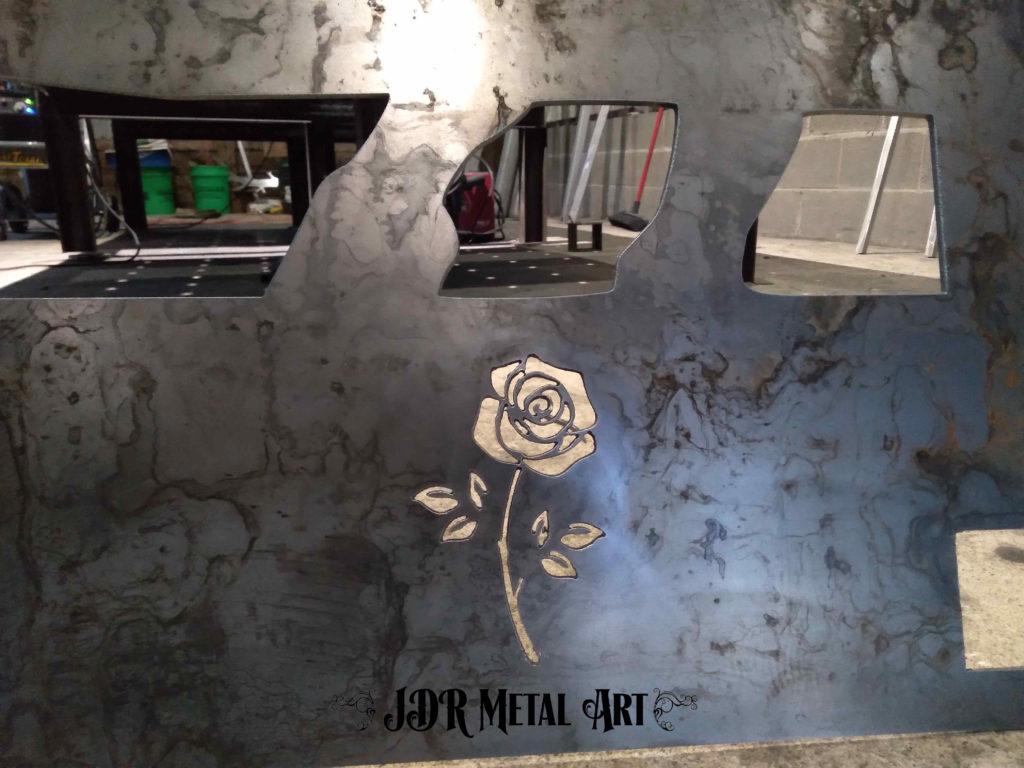 steel rose on driveway gate